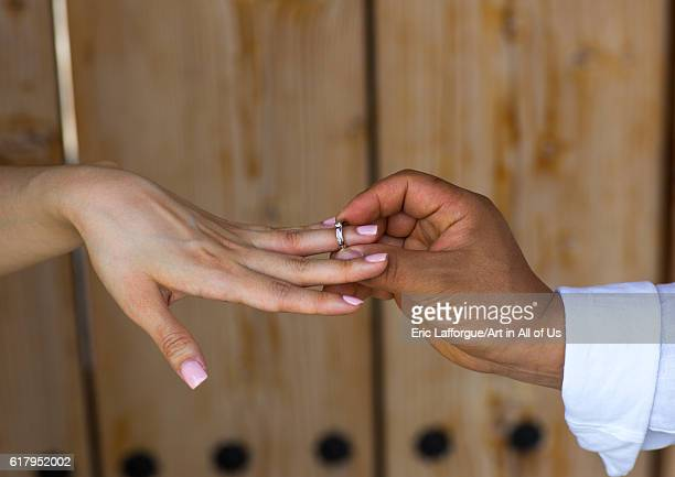North korean defector joseph park putting wedding ring on the finger of his south korean fiancee juyeon sudogwon paju South Korea on May 31 2016 in...