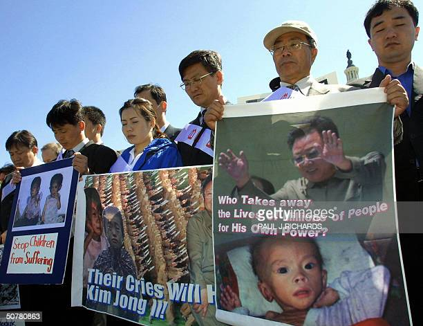 North Korean defectors and demonstrators pray for victims of the North Korean train crash during a North Korea Freedom Day rally 28 April 2004 on the...