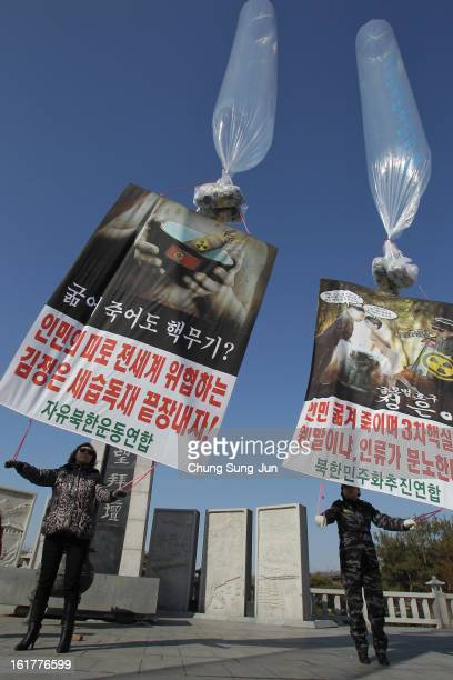 North Korean defectors now living in South Korea prepare to release balloons carrying propaganda leaflets denouncing North Korea's nuclear test at...