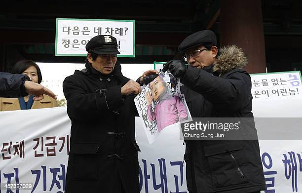 North Korean defectors who live in South Korea tear a portrait of North Korean leader Kim JongUn during an antiNorth Korea protest marking the second...