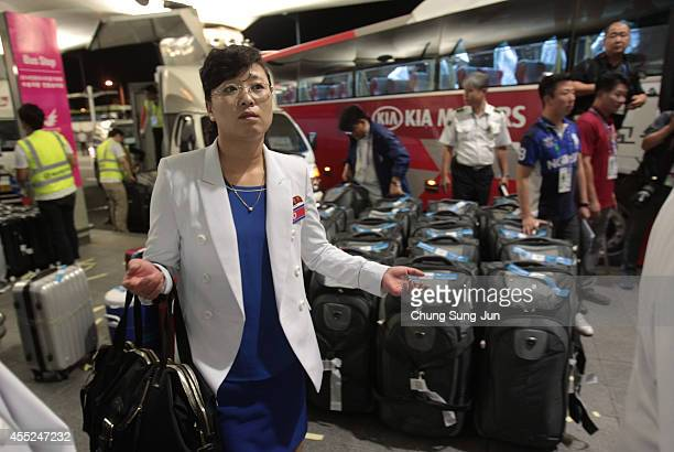 North Korean delegates arrive at Incheon International Airport on September 11 2014 in Incheon South Korea This is the first team of North Korean...