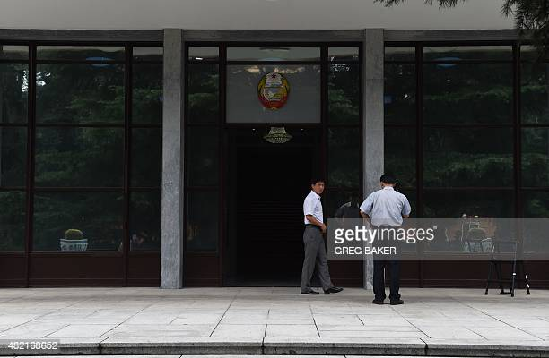 North Korean embassy staff members stand outside the embassy in Beijing on July 28 2015 North Korea's nuclear weapons are 'not a plaything' and their...