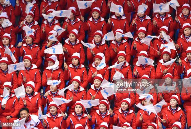 North Korean fans cheering from the tribunes during the figure skating pairs short program of the 2018 Winter Olympics in the Gangneung Ice Arena in...