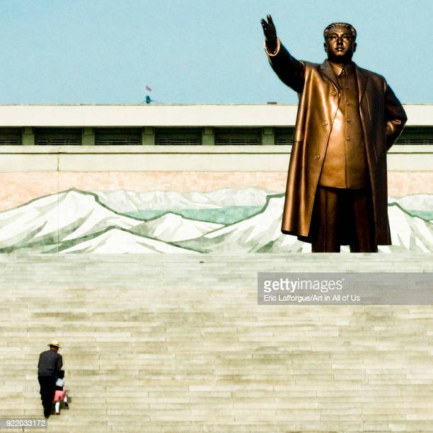 North Korean father and his son climbing the stairs leading to the statue of Kim il Sung in Mansudae Grand monument Pyongan Province Pyongyang North...