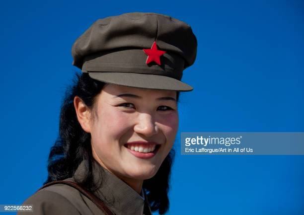 North Korean female guide smiling wearing cap with red star Ryanggang Province Samjiyon North Korea on September 19 2011 in Samjiyon North Korea