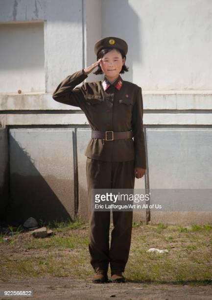 North Korean female soldier saluting South Pyongan Province Chonsam Cooperative Farm North Korea on September 12 2011 in Chonsam Cooperative Farm...