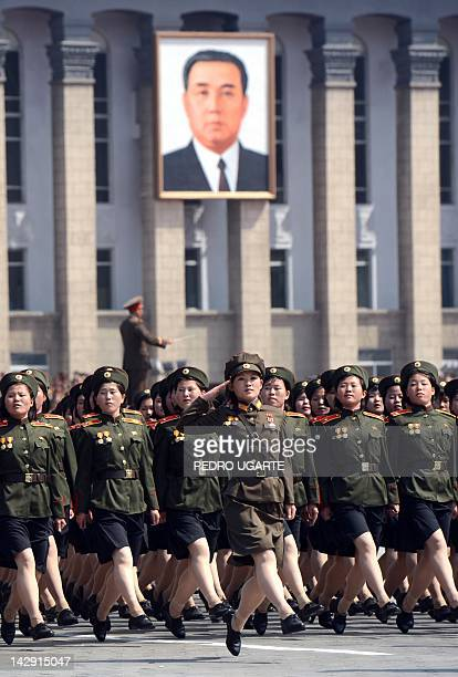 North Korean female soldiers march during a military parade to mark 100 years since the birth of the country's founder Kim IlSung in Pyongyang on...