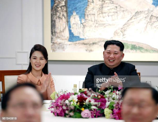 North Korean first lady Ri Solju and Leader Kim Jong Un attend the InterKorean Summit dinner on April 27 2018 in Panmunjom South Korea Kim and Moon...