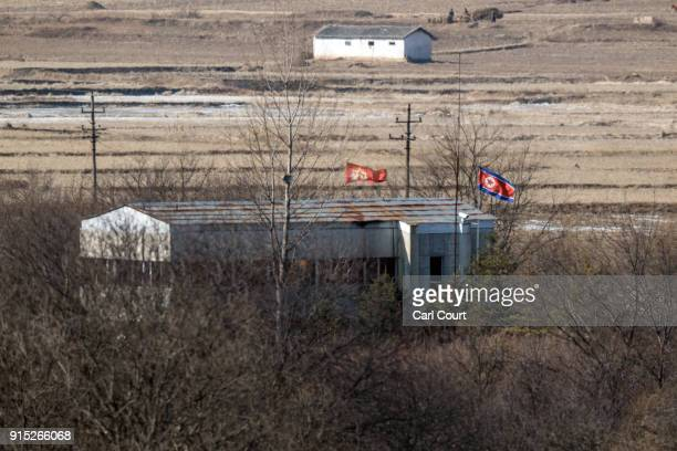 North Korean flag flies from a building in North Korea near the Demilitarized Zone between South and North Korea on February 7 2018 in Panmunjom...