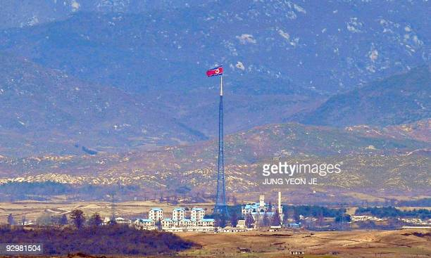 A North Korean flag flutters over the propaganda village of Gijungdong seen from a South Korean observation tower in Paju near the Demilitarized Zone...