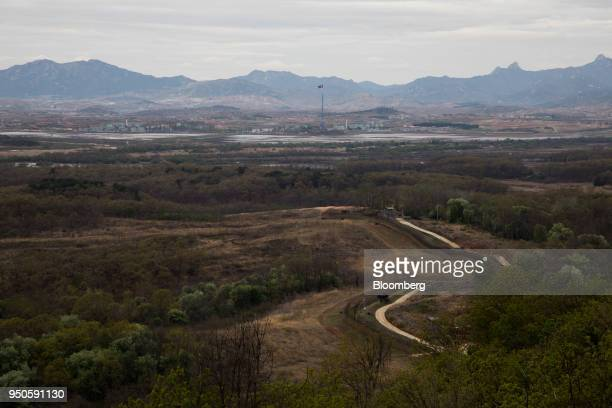 A North Korean flag flying over North Korea's Gijungdong village is seen from the Dorasan Observatory in the Demilitarized Zone in Paju South Korea...