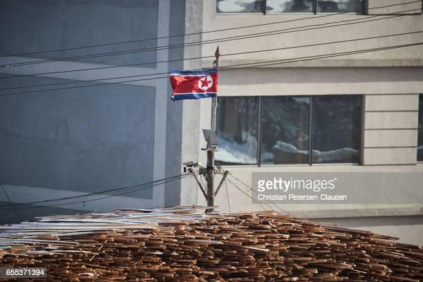 North Korean Flag waving at building