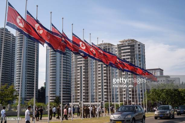 North Korean flags fly at half-mast as the country marks the 25th death anniversary of Kim Il Sung, at Mansu Hill in Pyongyang on July 8, 2019.