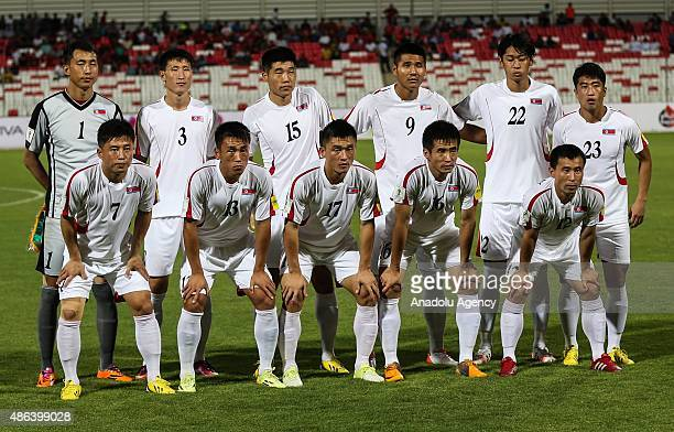 North Korean football players pose for a photo at the Bahrain National Stadium in the city of Rifaa during their AFC qualifying football match for...