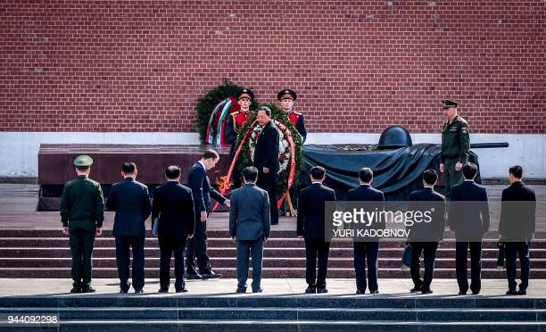 North Korean Foreign Minister Ri Yong-Ho attends a wreath laying ceremony at the Tomb of the Unknown Soldier near the Kremlin wall in Moscow on April...