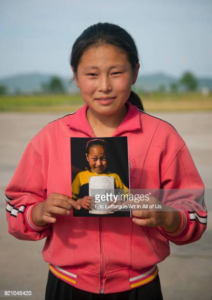 North Korean girl holding a picture of her taken two years before South Pyongan Province Chonsam Cooperative Farm North Korea on September 12 2011 in...