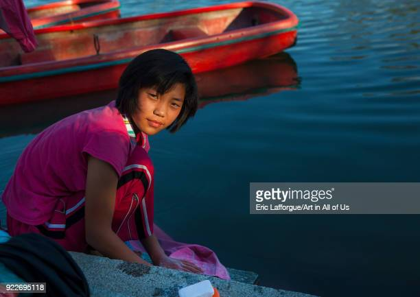 North Korean girl washing her clothes in the lake of the Songdowon international children's camp Kangwon Province Wonsan North Korea on September 10...