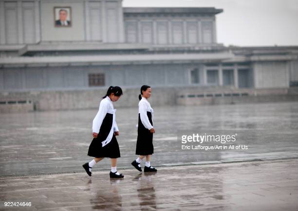 North Korean girls under the rain in Kumsusan palace of the sun that serves as the mausoleum for Kim Ilsung and Kim Jongil Pyongan Province Pyongyang...