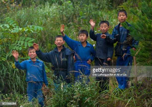 North Korean group of children waving hands in the countryside North Hamgyong Province Jung Pyong Ri North Korea on September 18 2011 in Jung Pyong...