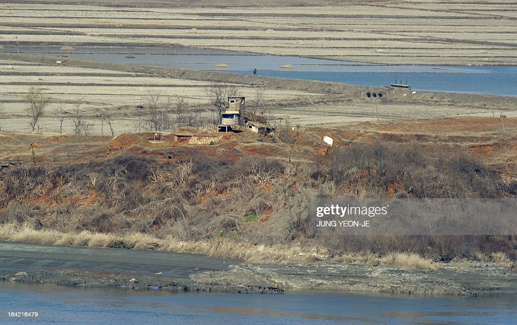 A North Korean guard post in the propaganda village of Gijeongdong is seen from a South Korean observatory post in the border city of Paju near the Demilitarized Zone (DMZ) dividing the two Koreas on March 21, 2013. North Korea issued an air raid warning and put its military on alert on March 21, South Korea's Unification Ministry said, in what appeared to be a drill at a time of heightened tensions.
