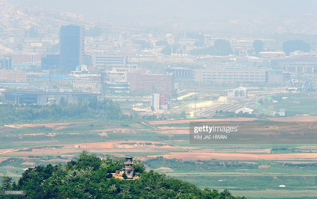 A North Korean guard post, seen from Paju, in the Demilitarised Zone stands in front of a joint industrial estate for South Korean firms in Kaesong just north of the tense border on June 2, 2010. Cross-border tensions were running high over the sinking of a South Korean warship in March.
