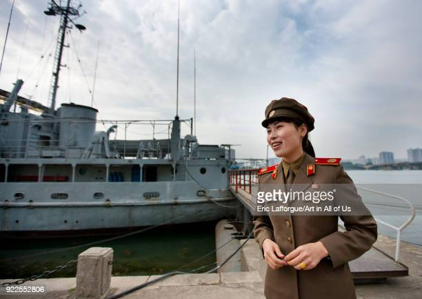 North Korean guide in front of Uss Pueblo american spy ship Pyongan Province Pyongyang North Korea on September 10 2011 in Pyongyang North Korea