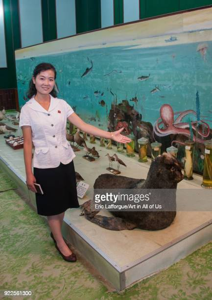 North Korean guide presenting a stuffed sea lion offered by Kim Jong il in Songdowon international children's union camp Kangwon Province Wonsan...