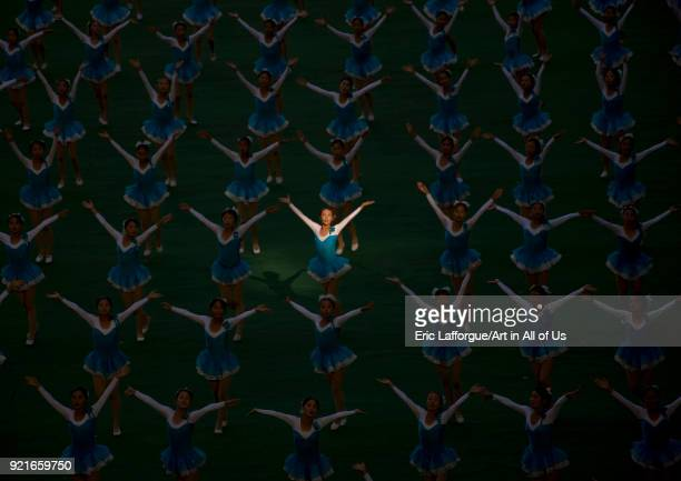 North Korean gymnast in a ray of sun during Arirang mass games in may day stadium Pyongan Province Pyongyang North Korea on September 12 2008 in...