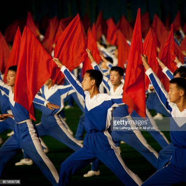 North Korean gymnasts with red flags during the Arirang mass games in may day stadium Pyongan Province Pyongyang North Korea on September 11 2008 in...