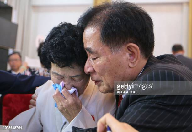 North Korean Jang Gi Sun cries with her South Korean brother Jang Juhwan as they bid farewell at the last meeting of a threeday family reunion event...