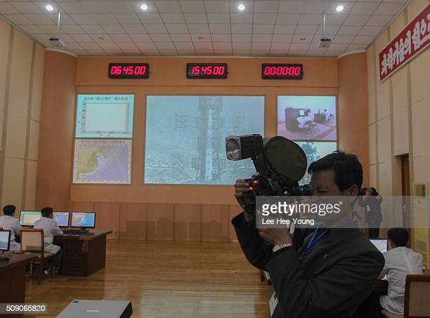 North Korean journalist shoots footage inside the control center at the Sohae Satellite Launching Center northwest of Pyongyang April 8 2012 in...