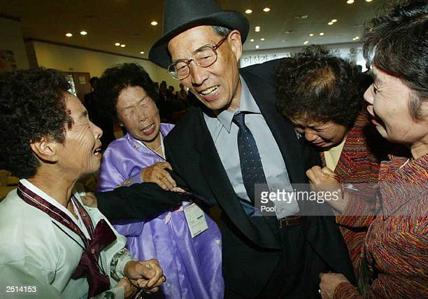 North Korean Kim Jong Soo meets his South Korean sisters during a separated family reunion September 20 2003 at a hotel of the Diamond Mountain in...