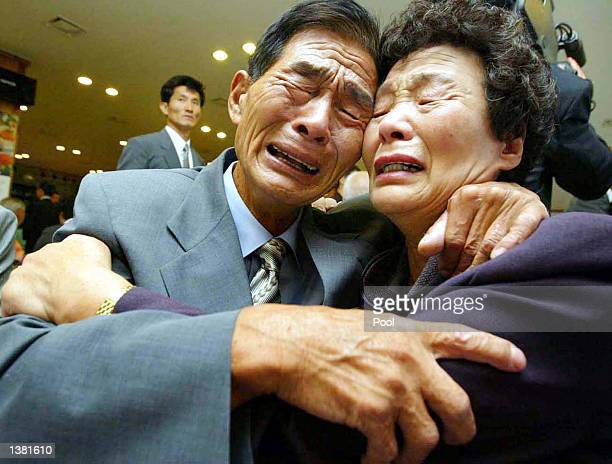North Korean Kim SeJin and his South Korean sister Kim OckRang cry during their first reunion in 50 years September 13 2002 at the Diamond Mountain...