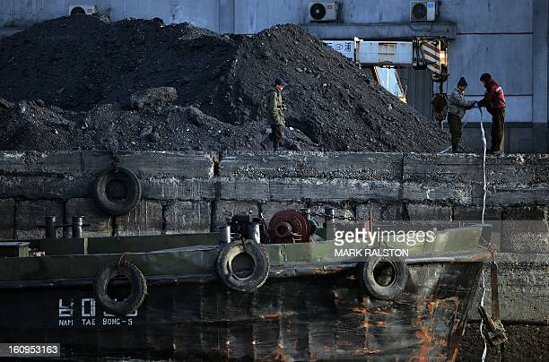 North Korean laborers work beside the Yalu River at the North Korean town of Sinuiju on February 8 2013 which is close to the Chinese city of Dandong...