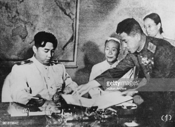 North Korean leader Kim Il-sung signs the Korean Armistice Agreement at Pyongyang, North Korea, assisted by General Nam Il , 1953.