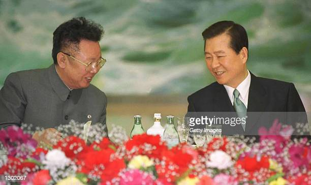 North Korean leader Kim Jong Il left and South Korean President Kim Daejung share a laugh June 14 2000 at a dinner ending the second day of talks at...