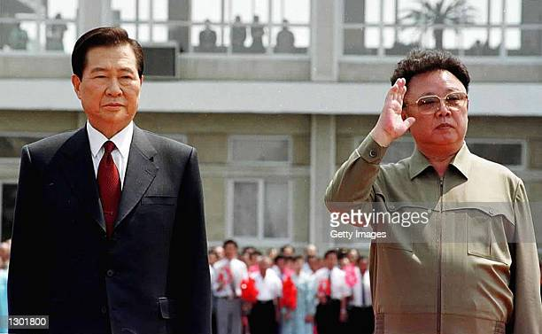 North Korean leader Kim Jong Il, right, and South Korean President Kim Dae-jung, left, meet to reconcile political differences as Kim Dae-jung...