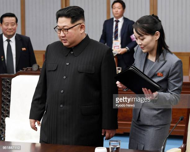 North Korean leader Kim Jong Un alongside Kim Yo Jong his sister and a senior official of the ruling Workers' Party attends a meeting with South...