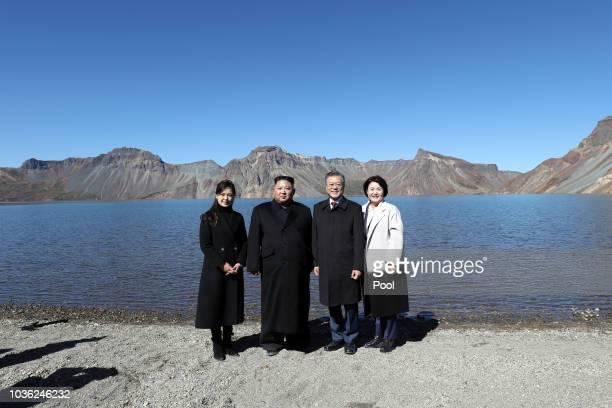 North Korean leader Kim Jong Un and his wife Ri Sol Ju pose with South Korean President Moon Jaein and his wife Kim Jungsook on the top of Mount...