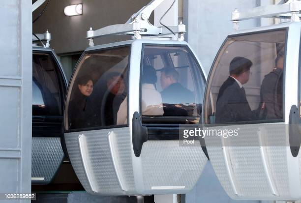 North Korean leader Kim Jong Un and his wife Ri Sol Ju sit in a gondola with South Korean President Moon Jaein and his wife Kim Jungsook as they go...
