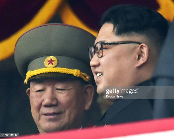 North Korean leader Kim Jong Un and Hwang Pyong So head of the General Political Bureau of the Korean People's Army watch a parade at Kim Il Sung...