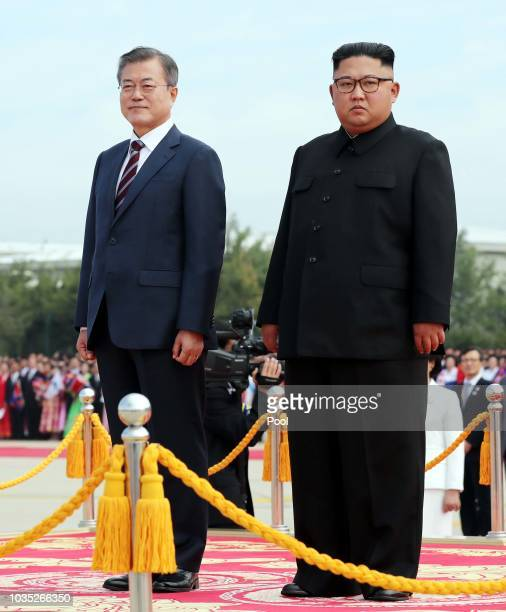North Korean Leader Kim Jong Un and South Korean President Moon Jaein review honour guards during a welcoming ceremony at Pyongyang Sunan...