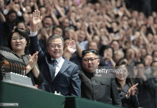 North Korean leader Kim Jong Un and South Korean President Moon Jae-in gesture as they watch the gymnastic and artistic performance at the May Day...