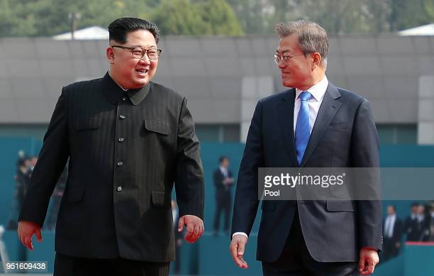 North Korean leader Kim Jong Un and South Korean President Moon Jaein walk after the official welcome ceremony for the InterKorean Summit on April 27...