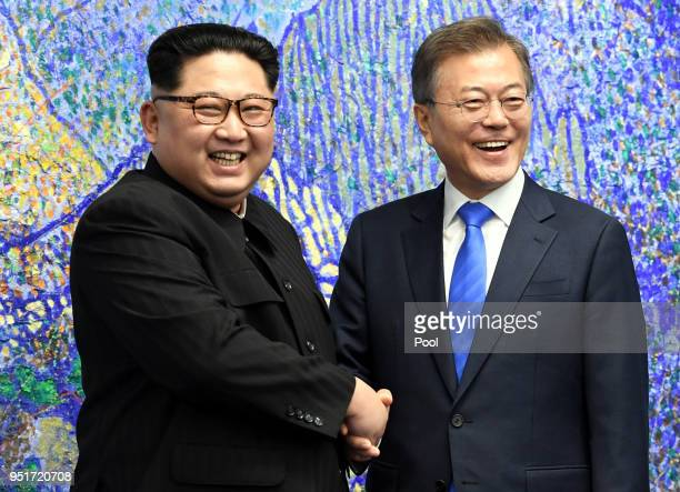 North Korean leader Kim Jong Un and South Korean President Moon Jaein pose for photos in front of Bukhansan Peace House for the InterKorean Summit on...