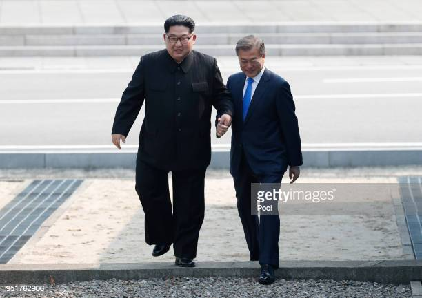 North Korean leader Kim Jong Un and South Korean President Moon Jaein cross back the military demarcation line to the south side after Moon crossing...