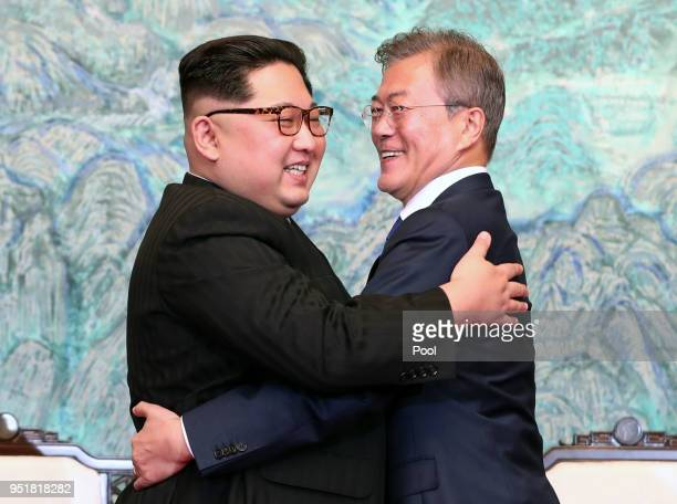 North Korean leader Kim Jong Un and South Korean President Moon Jae-in embrace after signing the Panmunjom Declaration for Peace, Prosperity and...
