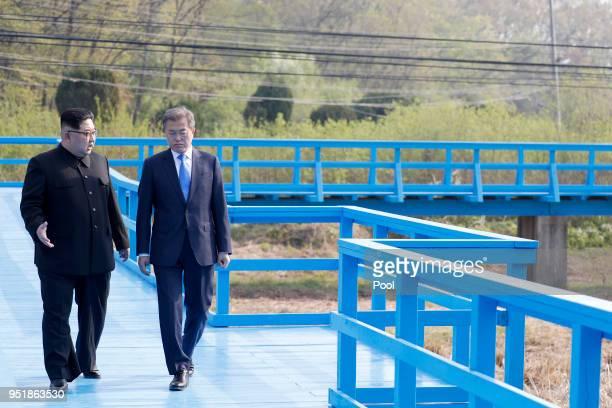North Korean leader Kim Jong Un and South Korean President Moon Jaein take a walk on the walk bridge during the InterKorean Summit on April 27 2018...