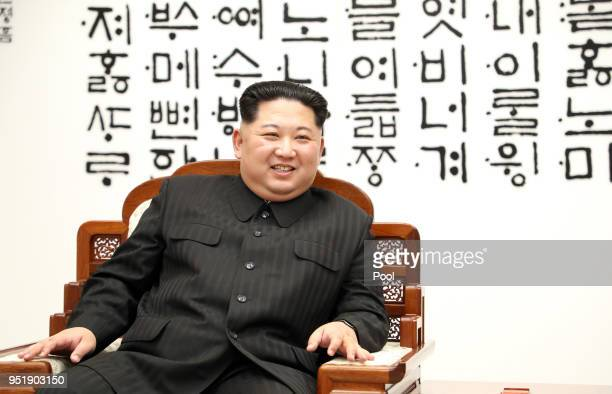 North Korean leader Kim Jong Un and South Korean President Moon Jaein are in talks during the InterKorean Summit on April 27 2018 in Panmunjom South...