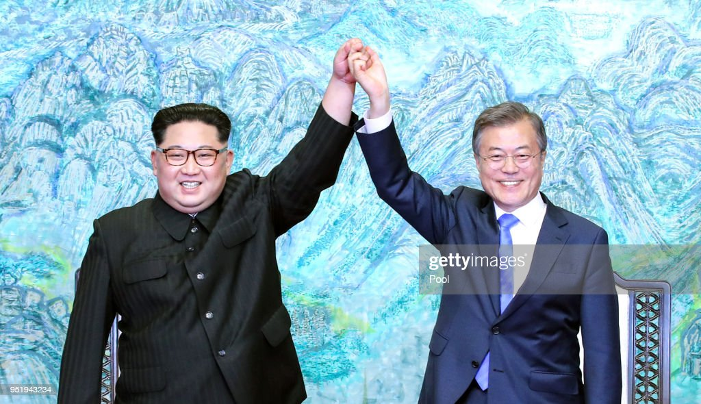 North Korean leader Kim Jong Un (L) and South Korean President Moon Jae-in (R) pose for photographs after signing the Panmunjom Declaration for Peace, Prosperity and Unification of the Korean Peninsula during the Inter-Korean Summit at the Peace House on April 27, 2018 in Panmunjom, South Korea. Kim and Moon meet at the border today for the third-ever Inter-Korean summit talks after the 1945 division of the peninsula, and first since 2007 between then President Roh Moo-hyun of South Korea and Leader Kim Jong-il of North Korea.